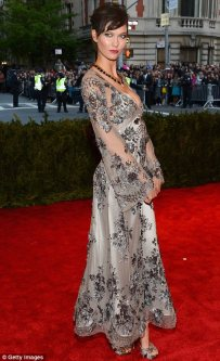 This is a dress you can wear all year round. Its interesting and gives a mystique to Karlie Kloss. Louis Vuttion