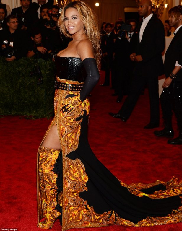 On fire in Givenchy. Love the classic gold detail.